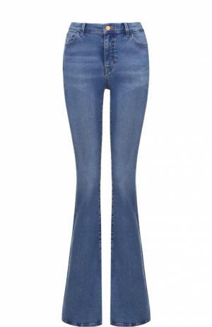 Расклешенные джинсы с декоративными потертостями MiH Jeans. Цвет: синий