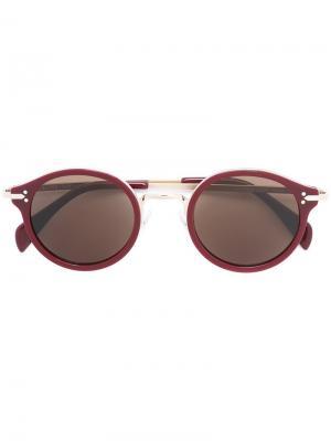 Солнцезащитные очки в круглой оправе Céline Eyewear. Цвет: красный